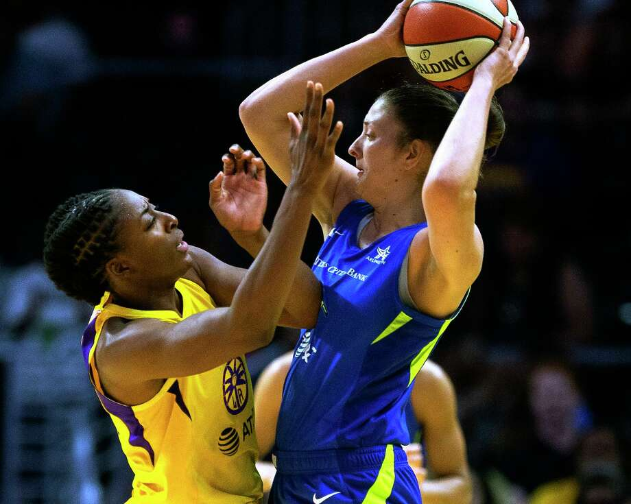 Los Angeles Sparks forward Nneka Ogwumike, left, defends against Dallas Wings' Theresa Plaisance during a WNBA basketball game in Los Angeles on Thursday, July 18. Plaisance was traded to the Connecticut Sun Tuesday. Photo: Damian Dovarganes / Associated Press / Copyright 2019 The Associated Press. All rights reserved.