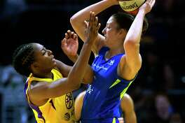Los Angeles Sparks forward Nneka Ogwumike, left, defends against Dallas Wings' Theresa Plaisance during a WNBA basketball game in Los Angeles on Thursday, July 18. Plaisance was traded to the Connecticut Sun Tuesday.
