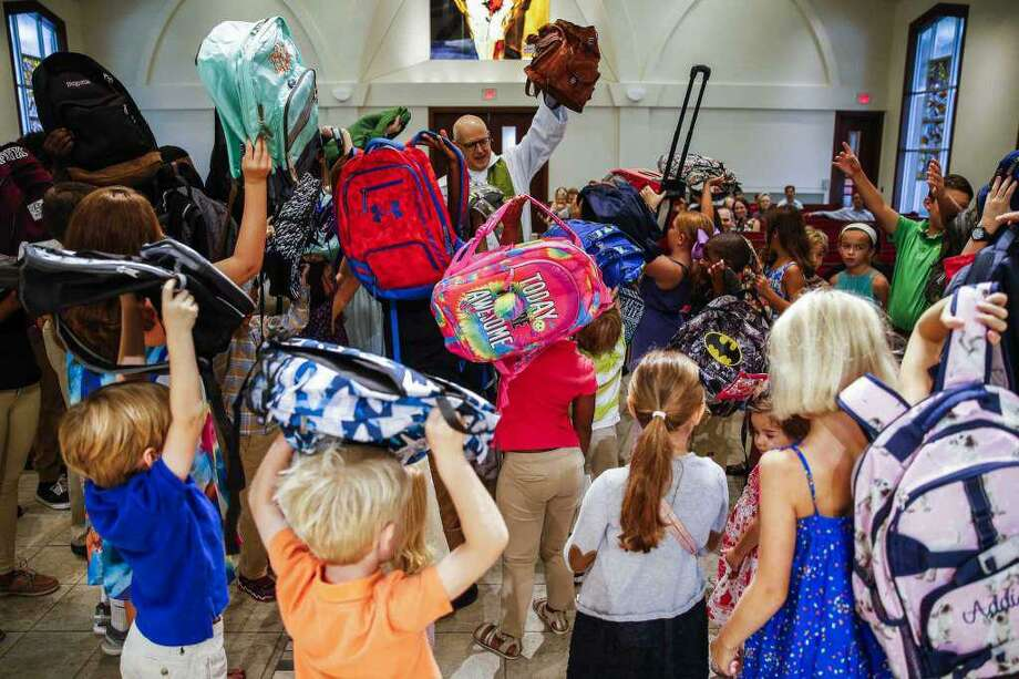 The popular Blessing of the Backpacks at St. Francis Episcopal Church, 345 Piney Point Road, returns in August. Students are invited to bring their backpacks for blessings at the 9 a.m. services on Aug. 12, 19 and 26. The event was started by Father Bob Wismer, above, about 10 years ago. Photo: Michael Ciaglo / Michael Ciaglo