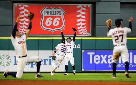 Houston Astros center fielder George Springer (4) celebrates the final out in the Astros 4-0 win over the Yankees in Game 7 of the ALCS at Minute Maid Park, Satuday, Oct. 21, 2017, in Houston.