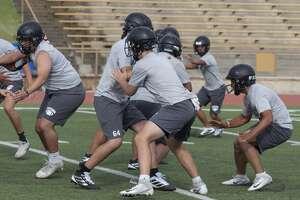 Andrews' players run drills 08/06/19 during the morning practice. Tim Fischer/Reporter-Telegram