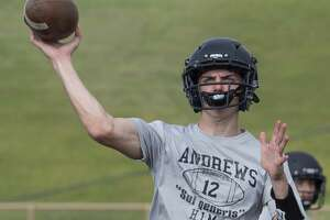 Andrews' quarterback Brett Leach looks to pass 08/06/19 during morning practice. Tim Fischer/Reporter-Telegram