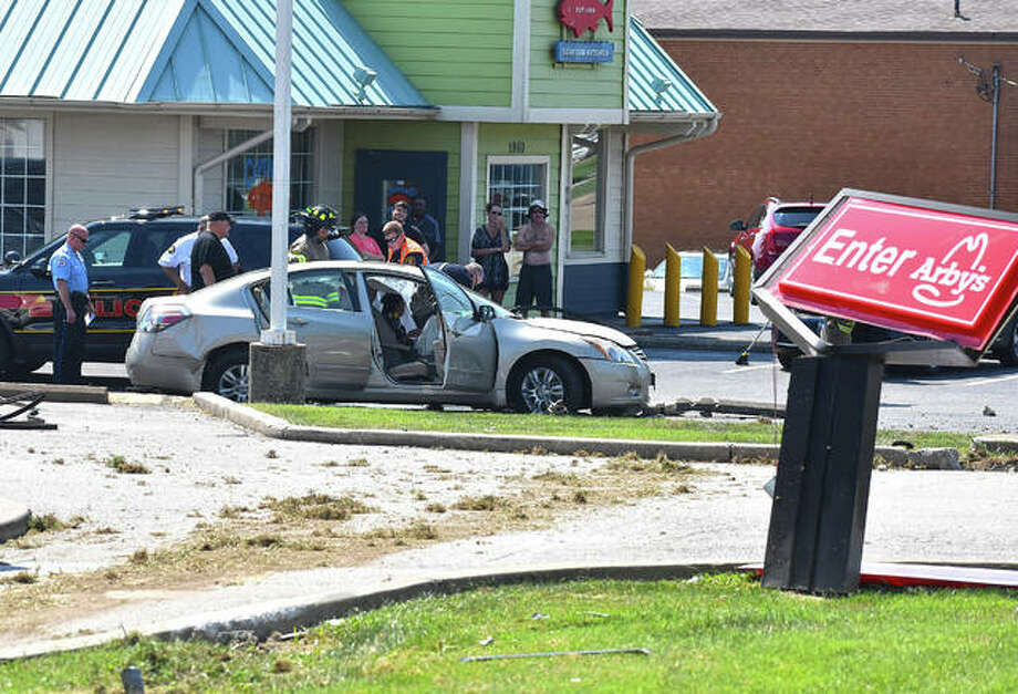 Edwardsville fire and police personnel respond to a two-vehicle crash on Troy Road late Tuesday morning with community members nearby. Photo: Matt Kamp | The Intelligencer