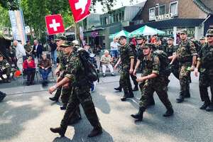 "Soldiers from Switzerland participate in ""The Walk of the World"" in Nijmegen in July."
