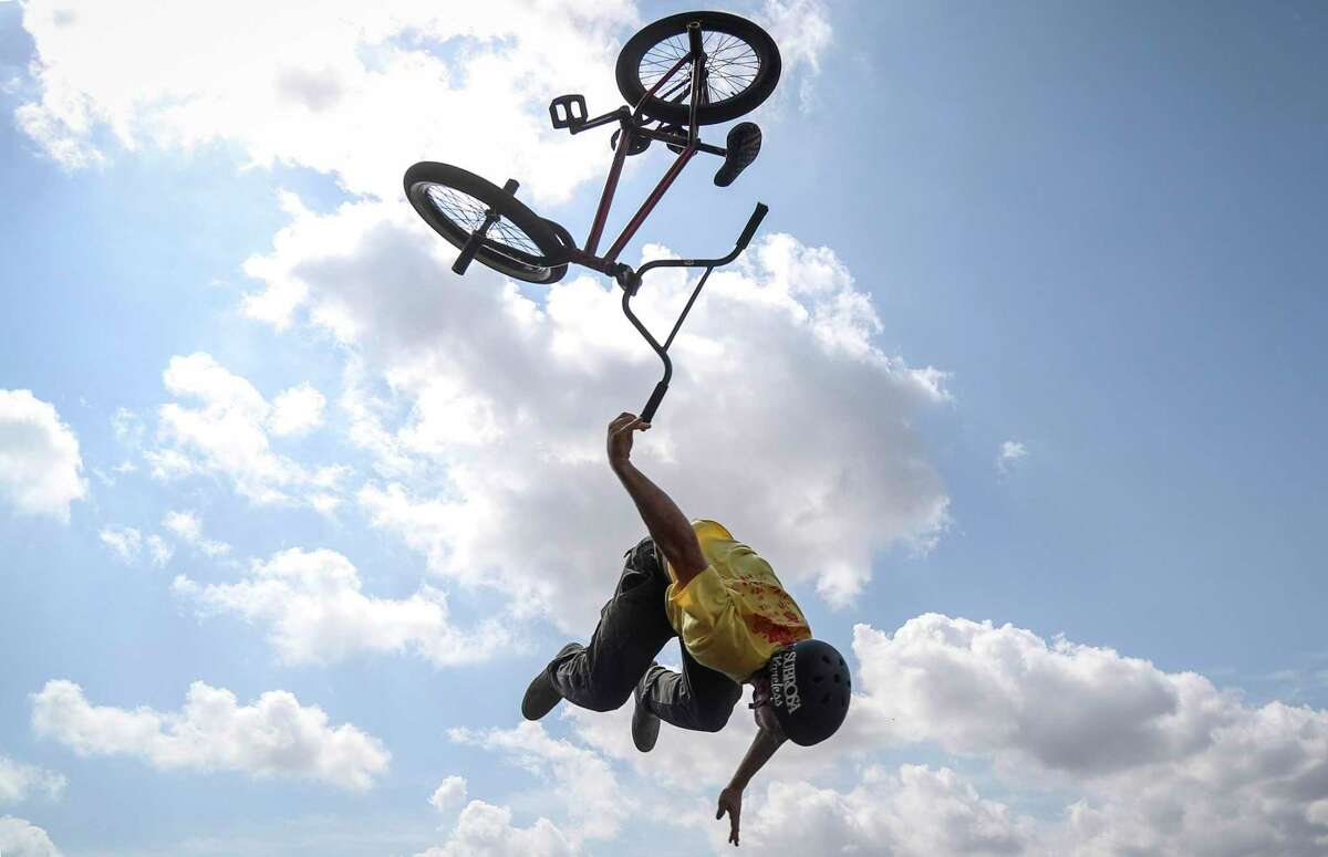 """Eli Kravetz, who has been riding for about six years, bails while attempting a backflip on the pump track at the North Houston Bike Park. """"I wasn't really feeling it, but I wanted it,"""" Kravetz said. The bike park is scheduled to open Aug. 16."""
