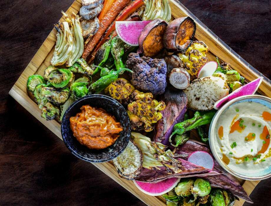 The chef's vegetable board at Traveler's Table comes with a rotating selection of items such as crispy Indian spiced okra, North African cauliflower and Mexican street corn. Photo: Debora Smail
