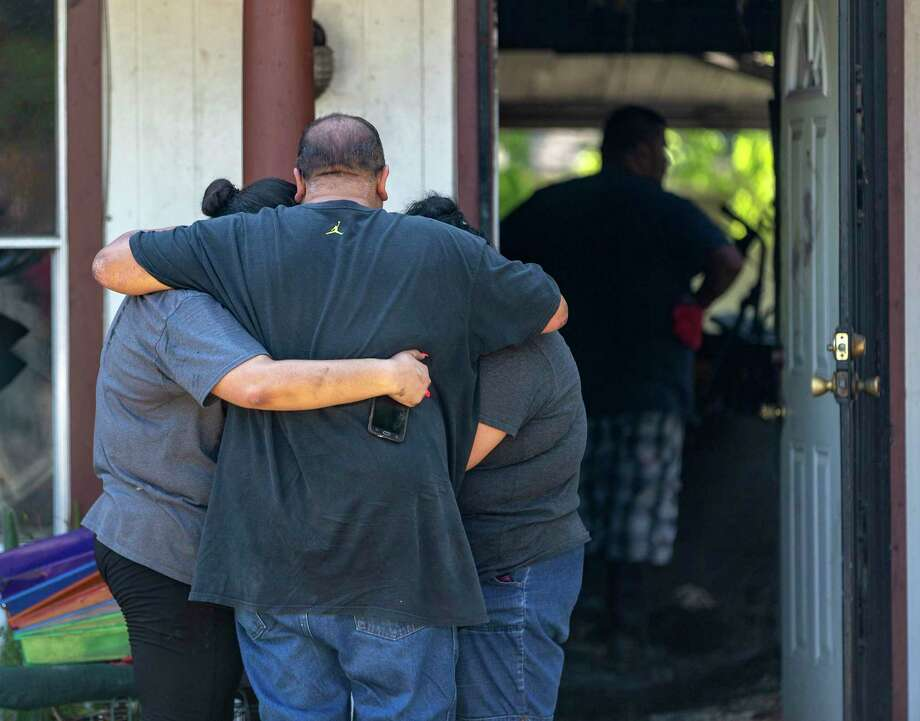 Family members gather Tuesday at a home in the 7500 block of Dream Valley where an apparent triple murder-suicide happened the night before. Photo: William Luther /Staff Photographer / ©2019 San Antonio Express-News
