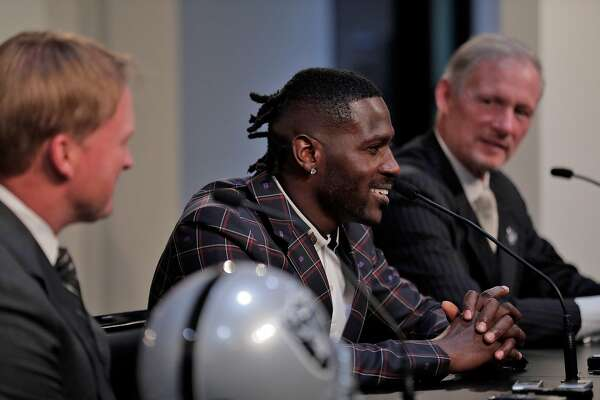Antonio Brown, center, with Raiders head coach Jon Gruden, left, and General Manager Mike Mayock, right, as the Raiders announce the acquisition of the wide receiver at their team headquarters in Alameda, Calif., on Wednesday, March 13, 2019.