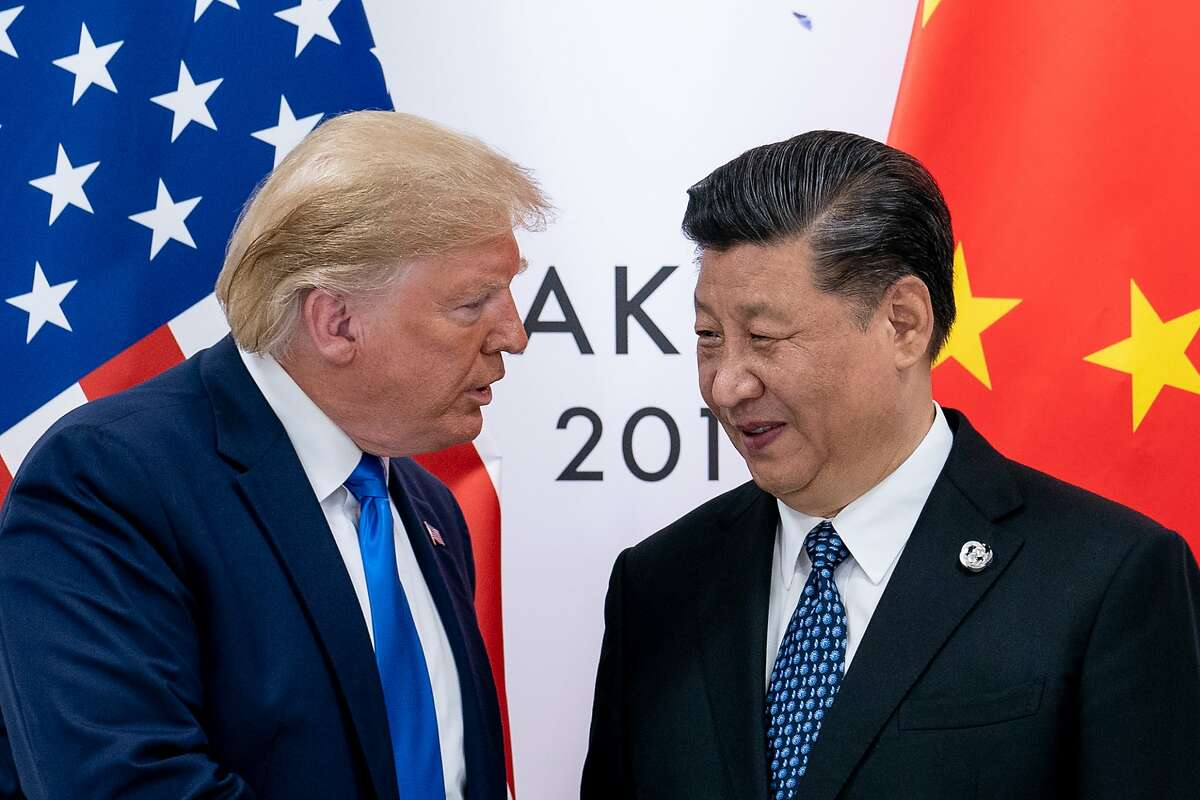 FILE-- President Donald Trump and President Xi Jinping of China at the G-20 Summit in Osaka, Japan, June 29, 2019.