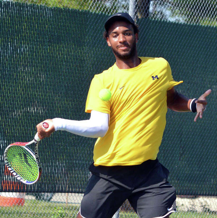 Andrew Fenty returns a shot during his singles match against Carson Haskins on Tuesday morning in the Qualifying Tournament for the Edwardsville Futures.