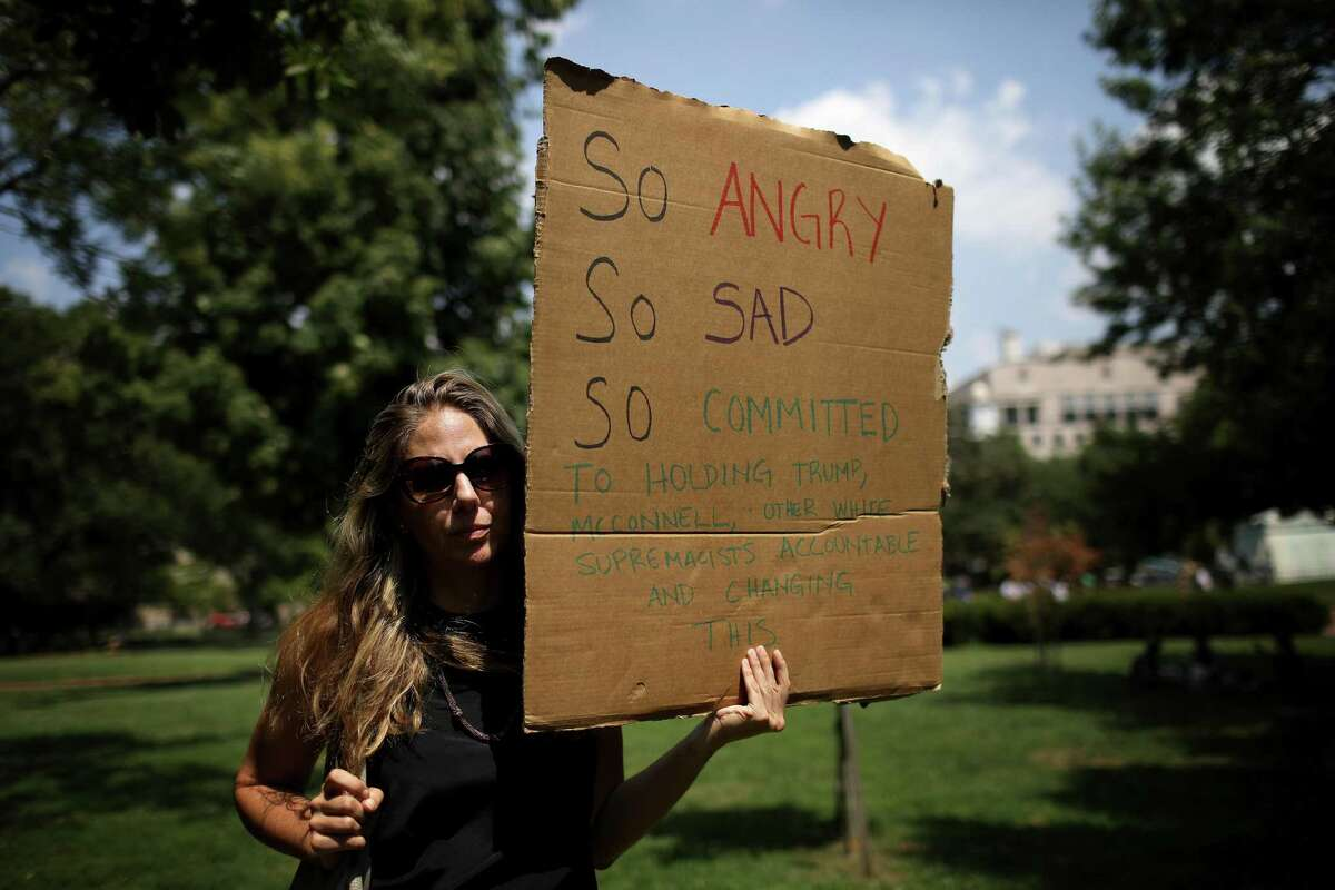 WASHINGTON, DC - AUGUST 06: In the wake of mass shootings in El Paso, Texas and Dayton, Ohio, activists gather in Lafayette Park across from the White House during a gun reform legislation rally sponsored by various protest groups August 6, 2019 in Washington, DC. Activists gathered to demand that Donald Trump cease his racist, violence-inducing attacks on the Latinos, immigrants and communities of color, and to urge the Senate to pass H.R. 8, a bipartisan background checks act passed by the House.(Photo by Win McNamee/Getty Images)