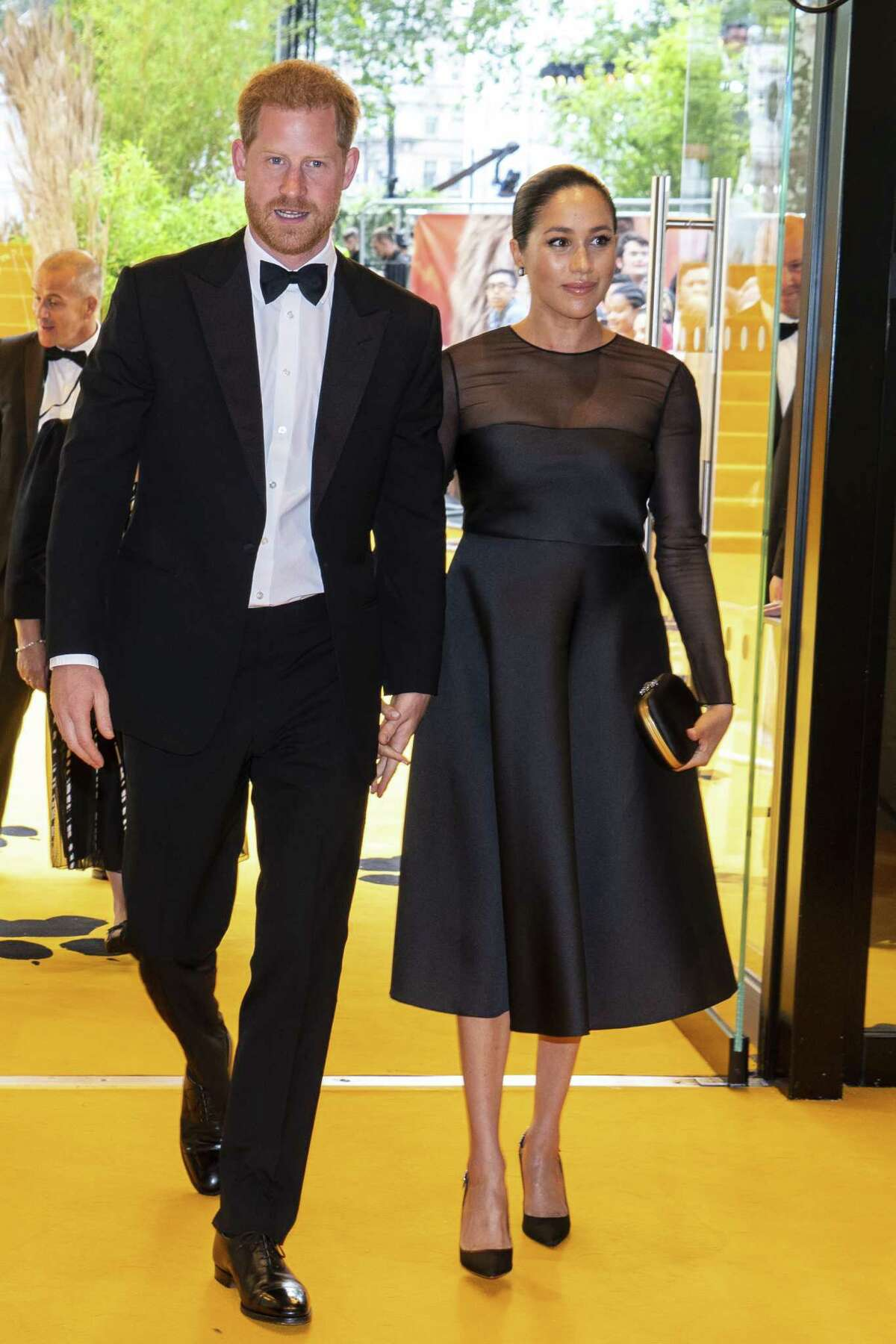 LONDON, ENGLAND - JULY 14: Prince Harry, Duke of Sussex and Meghan, Duchess of Sussex arrive to attend the European Premiere of Disney's