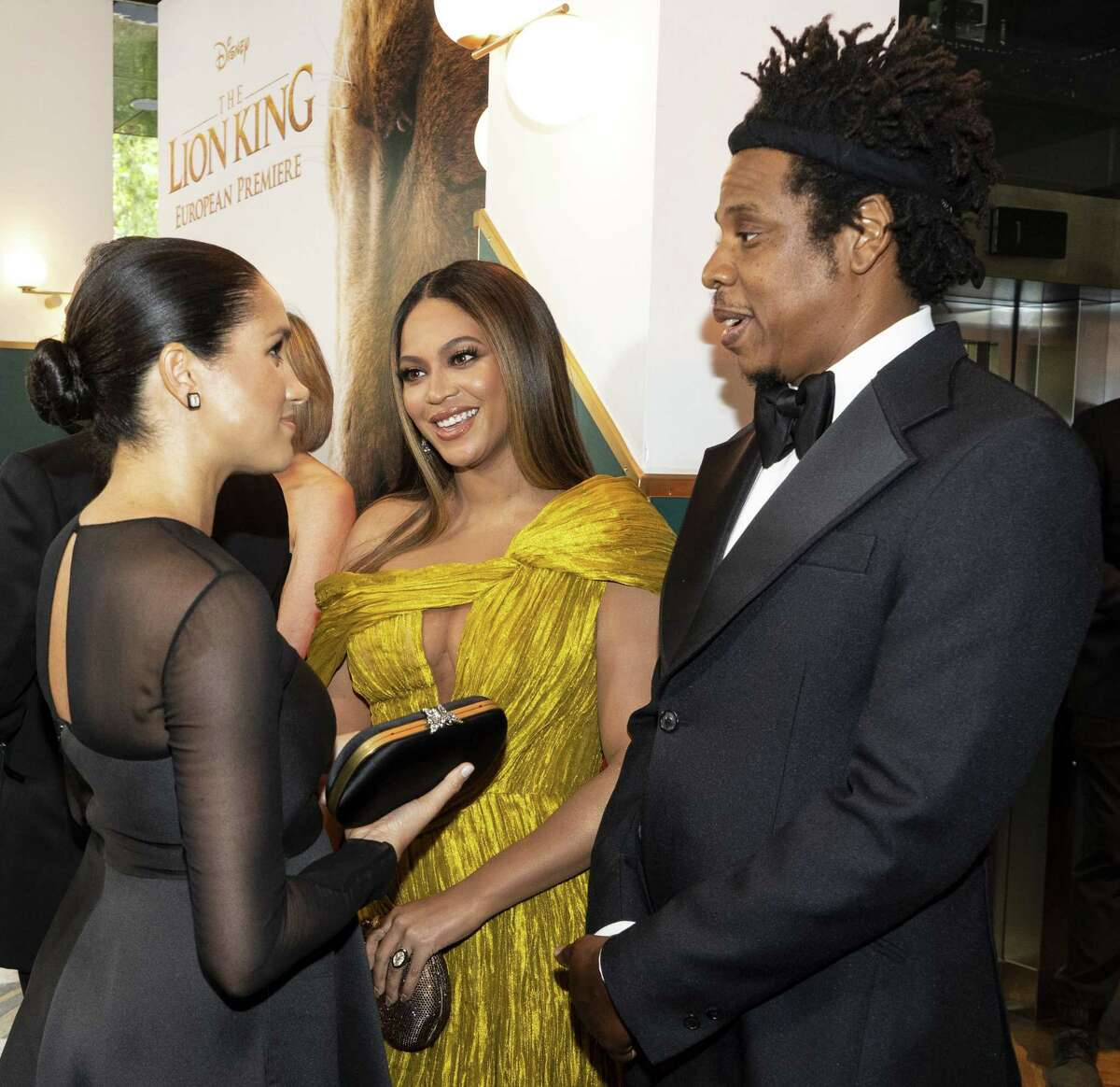 Britain's Meghan, Duchess of Sussex (L) meets cast and crew, including US singer-songwriter Beyoncé (C) and her husband, US rapper Jay-Z (R) as she attends the European premiere of the film The Lion King in London on July 14, 2019. (Photo by Niklas HALLE'N / POOL / AFP)NIKLAS HALLE'N/AFP/Getty Images