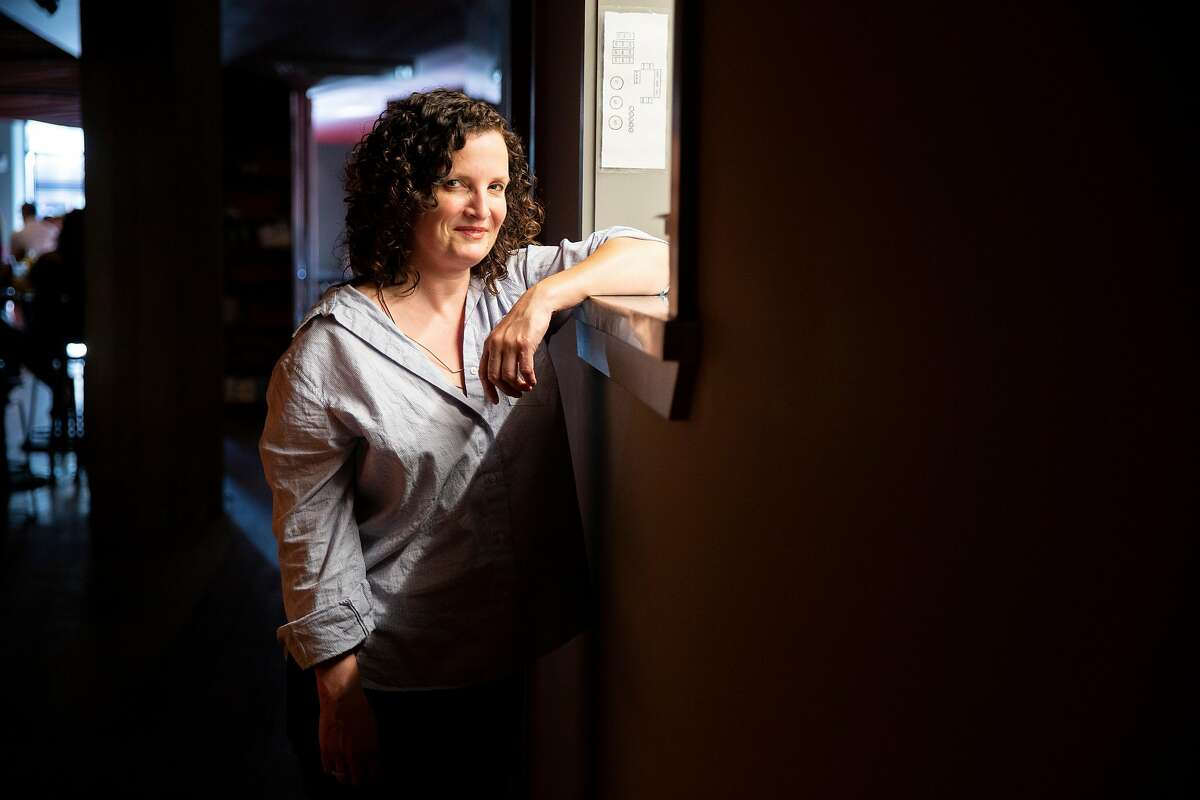 A portrait of bar owner Jennifer Colliau at Here's How, Thursday, Aug. 1, 2019, in Oakland, Calif. The bar is located at 1780 Telegraph Ave.