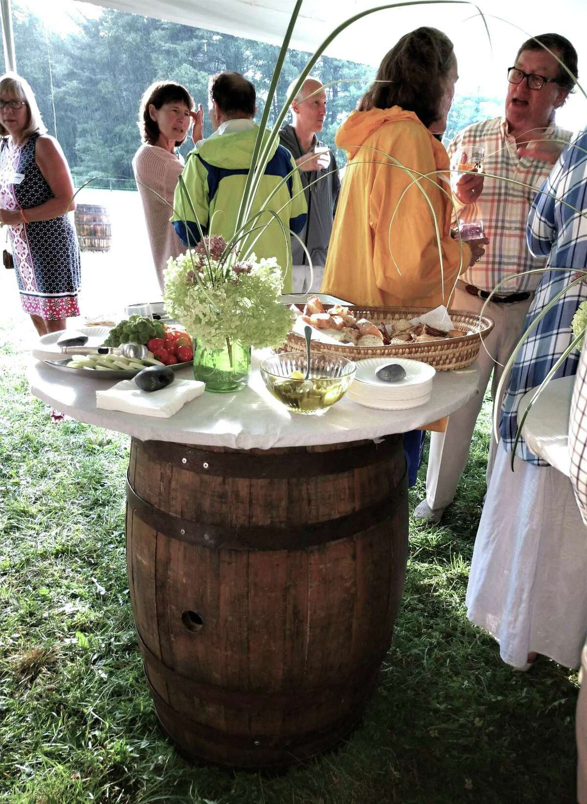 Guests gathered around a barrel in the cocktail hour tent.