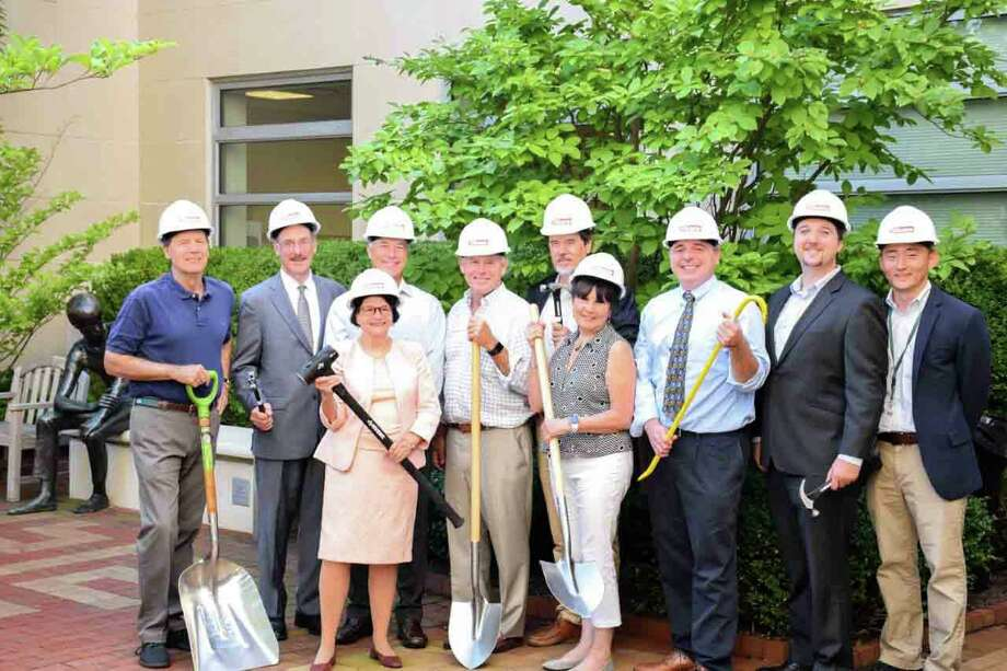 The Greenwich Library's renovation team poses in the Baxter Courtyard. When completed, the redesigned Baxter Courtyard will serve as an additional primary entrance to the Main Library and lead to a new Café and Center for Education & Culture on the lower level. Pictured, from left, back row: Rob Marks, President, Greenwich Library Board of Trustees; Tom Heagney, Co-Chair, Building Committee; Hank Ashforth, Co-Chair, Building Committee; Andy Fox, Owner's Representative, Stone Harbor; Michael Tribe, Architect, Peter Gisolfi Associates; Joseph A. Williams, Greenwich Library Deputy Director; Ed Sheeran, Gilbane Building Company; Jae Chu, Gilbane Building Company. Front row: Barbara Ormerod-Glynn, Greenwich Library Director; Patricia Montero, Architectural Designer, Peter Gisolfi Associates. Photo: Contributed /