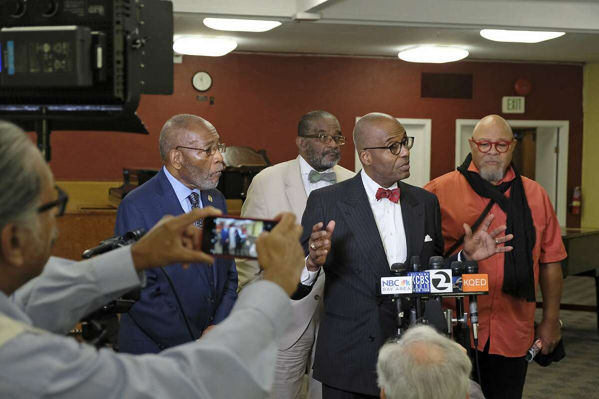 African American leaders from left, local NAACP President Dr. Amos Brown, Rev. Arnold Townsend, gesturing, columnist Noah Griffin, gesturing, and artist Dewey Crumpler voice their support for keeping a controversial mural at Washington High School during a news conference Tuesday, Aug. 6, 2019, in San Francisco. The controversial 13-panel, 1,600-square foot mural, the