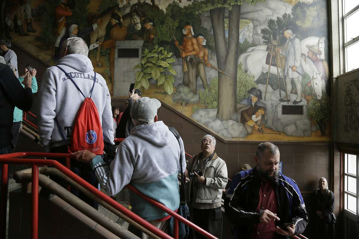 People fill the main entryway of George Washington High School to view the controversial 13-panel, 1,600-square foot mural, the