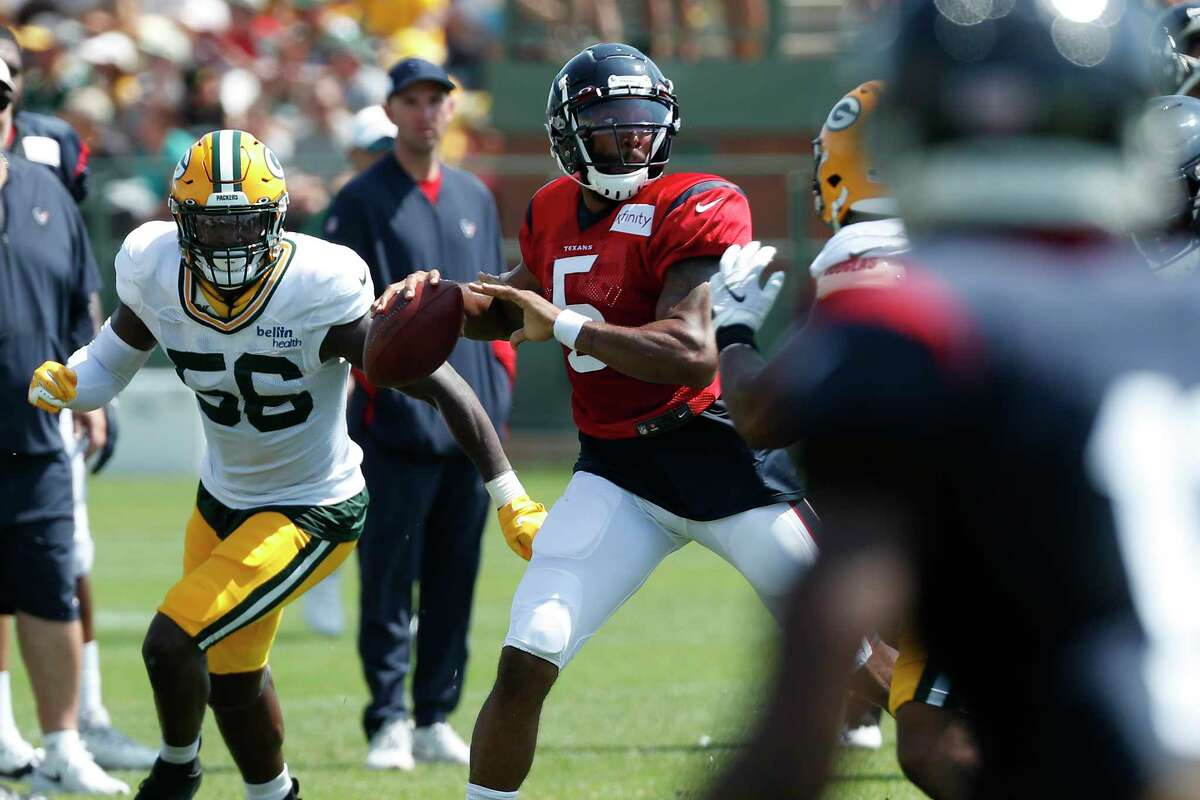Houston Texans quarterback Joe Webb (5) throws a pass against the Green Bay Packers defense during a joint training camp practice on Tuesday, Aug. 6, 2019, in Green Bay, Wis.