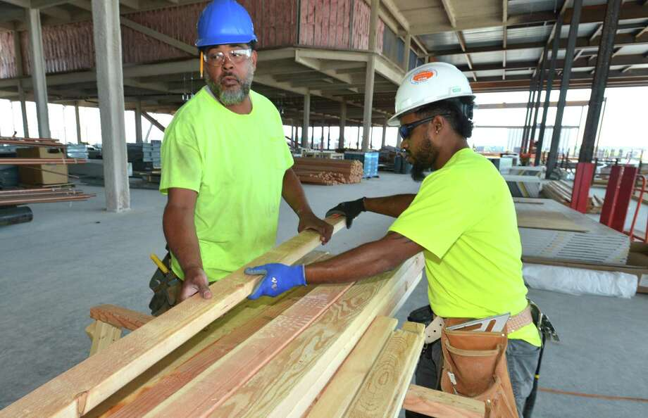 Carpentry intern Jason Kenworthy works alongside journeyman carpenter Manoah Dundar while learning the construction trade at the SoNo Collection mall through General Growth Properties internship program on Wednesday July 18, 2018 in Norwalk Conn. Photo: Alex Von Kleydorff / Hearst Connecticut Media / Norwalk Hour