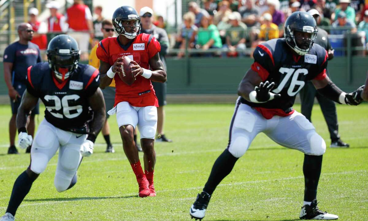 Houston Texans quarterback Deshaun Watson (4) drops back to pass behind running back Lamar Miller (26) and offensive tackle Seantrel Henderson (76) during a joint training camp practice with the Green Bay Packers on Tuesday, Aug. 6, 2019, in Green Bay, Wis.