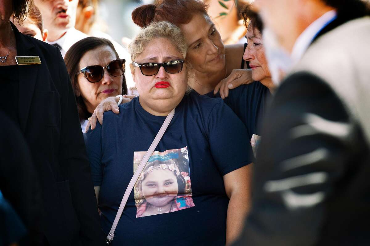 The mother of Keyla Salazar, Lorena Pimentel de Salazar, at center, reacts as the casket is loaded into the hearse at Our Lady of Guadalupe on Tuesday, Aug. 6, 2019, in San Jose, Calif. Keyla Salazar, 13, was a victim of the Gilroy shooting.