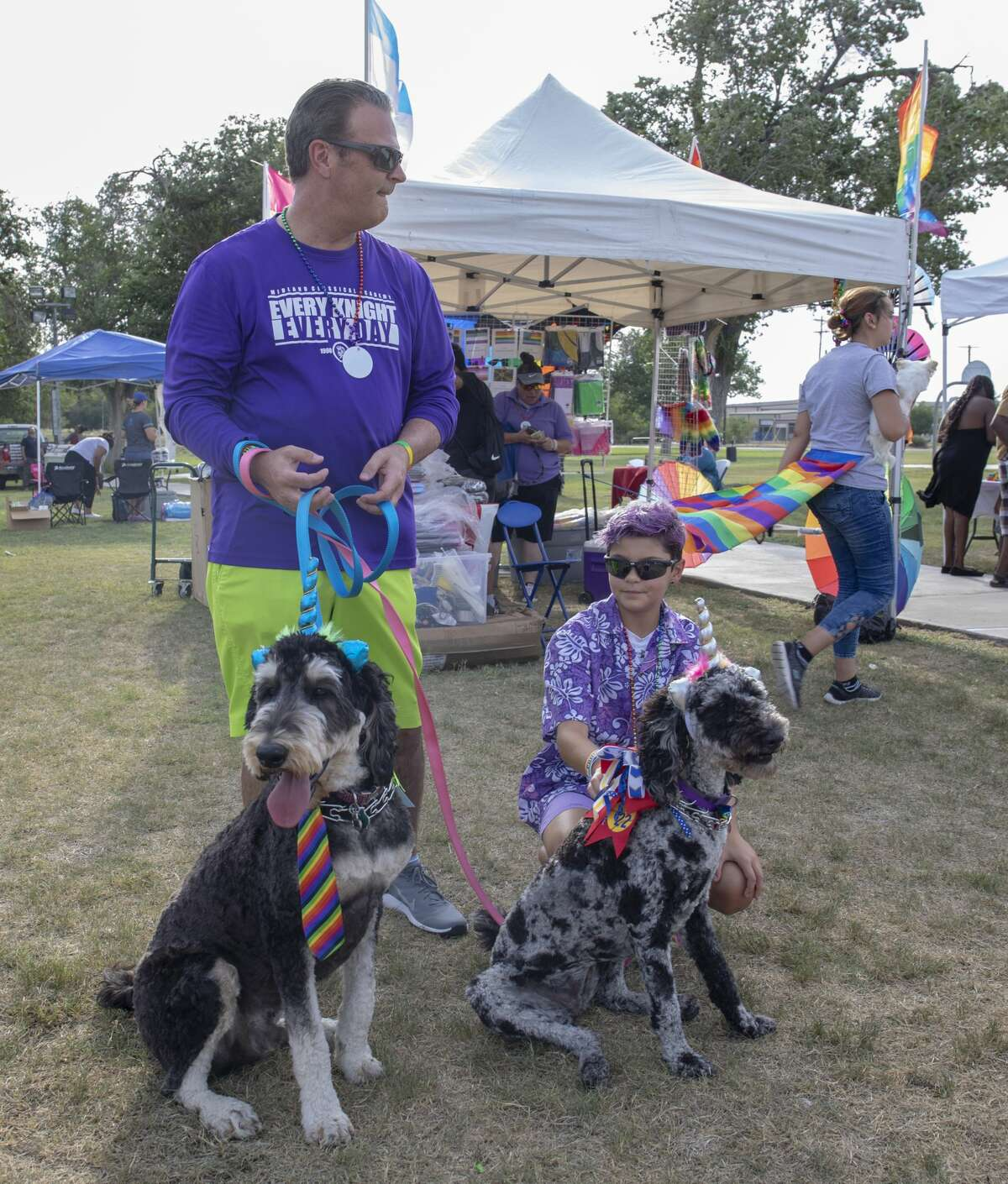 Paul and Harper Colwell with their dogs Baxter and Scout attend the first Basin Pride was Friday, Aug. 2, 2019 at McKinney Park in Odessa.