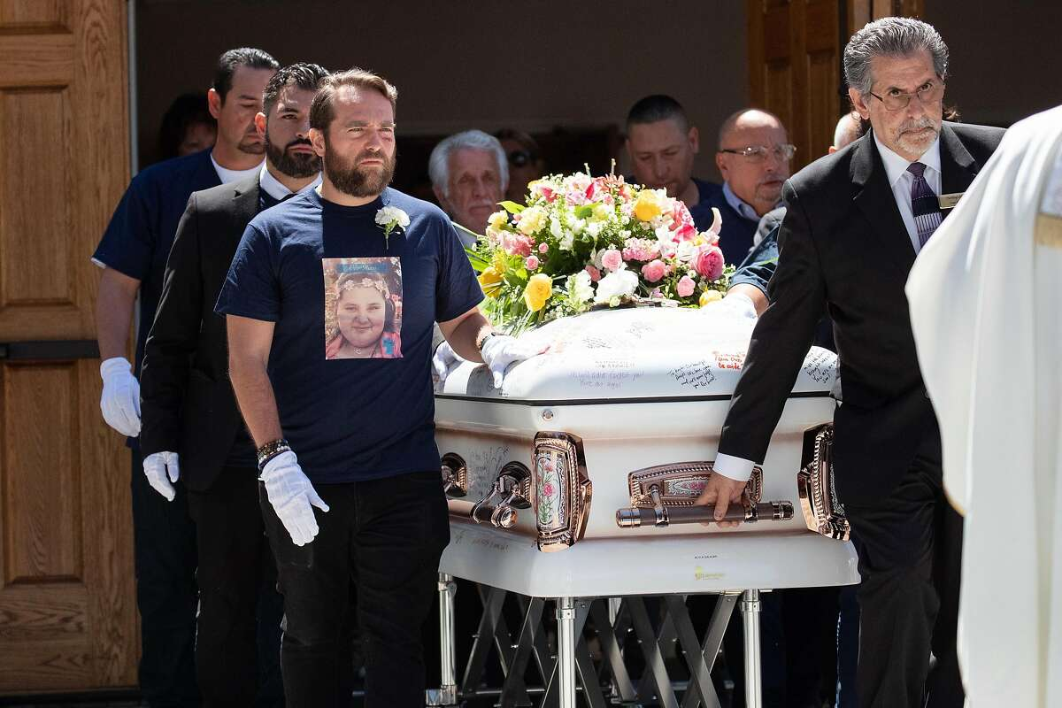 The funeral procession exits the church as friends and family gather to honor the life of Keyla Salazar, 13, a Gilroy shooting victim, at Our Lady of Guadalupe on Tuesday, Aug. 6, 2019, in San Jose, Calif.