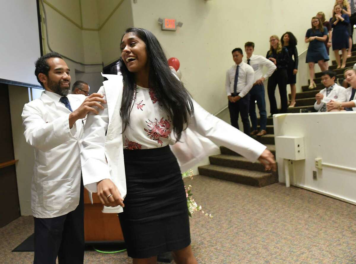 Incoming medical student Ariane Ramiochan of Albany, N.Y. receives her white medical coat during the White Coat Ceremony at Albany Medical College on Tuesday, Aug. 6, 2019 in Albany, N.Y. (Lori Van Buren/Times Union)