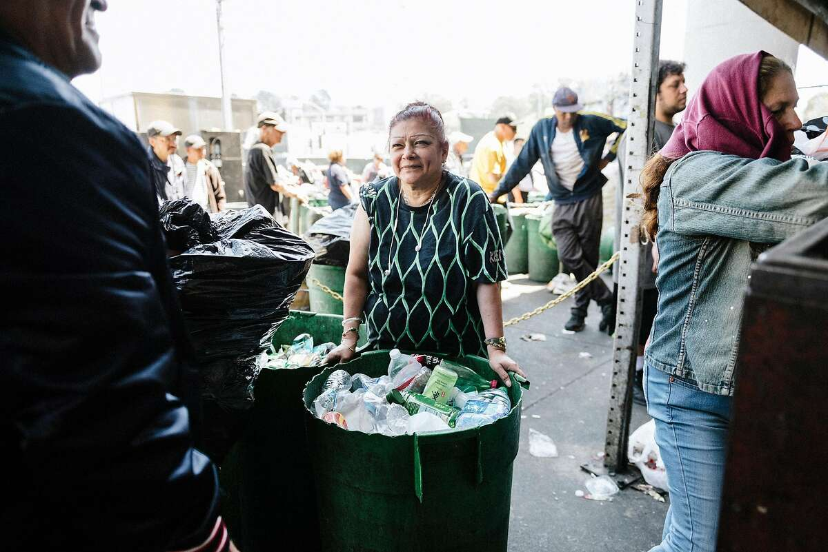 Patricia Vasquez of Daly City, waits in line to have her recycling weighed, at Our Planet Recycling in San Francisco, Calif, on Tuesday, August 6, 2019.