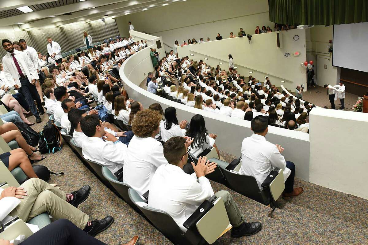 Incoming medical students from the Class of 2023 receive their white medical coat during the White Coat Ceremony at Albany Medical College on Tuesday, Aug. 6, 2019 in Albany, N.Y. (Lori Van Buren/Times Union)