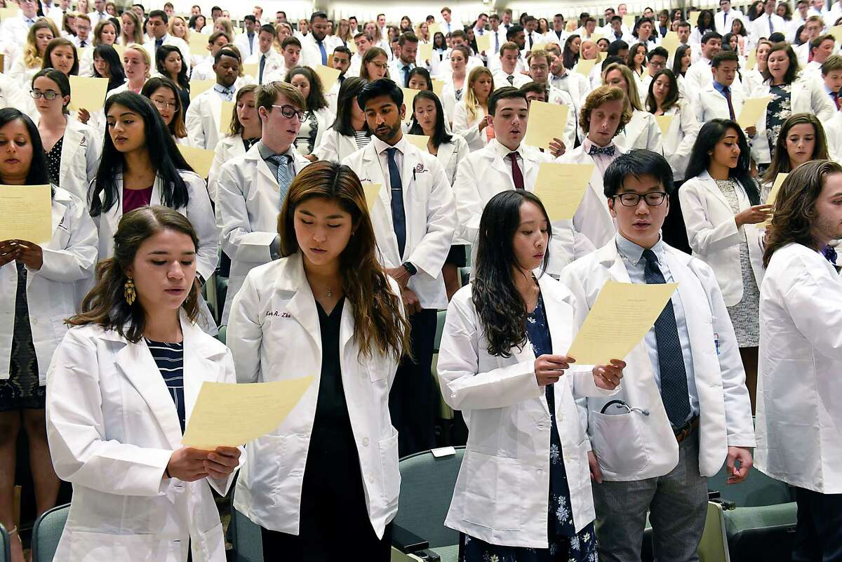 Incoming medical students from the Class of 2023 recite the Hippocratic Oath during the White Coat Ceremony at Albany Medical College on Tuesday, Aug. 6, 2019 in Albany, N.Y. (Lori Van Buren/Times Union)