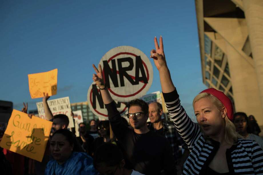 Demonstrators march toward the National Rifle Association Convention in Dallas last year. A reader defends the NRA following the two mass shootings that occurred over the weekend. Photo: TAMIR KALIFA /NYT / NYTNS