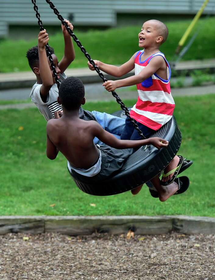 In this file photo, children enjoy a ride on a tire swing at the Ella B. Scantlebury Park on Ashmun Street in New Haven. Now alders have approved grants from several sources toward a skate park at Scantlebury Park. Photo: / Hearst Connecticut Media File Photo