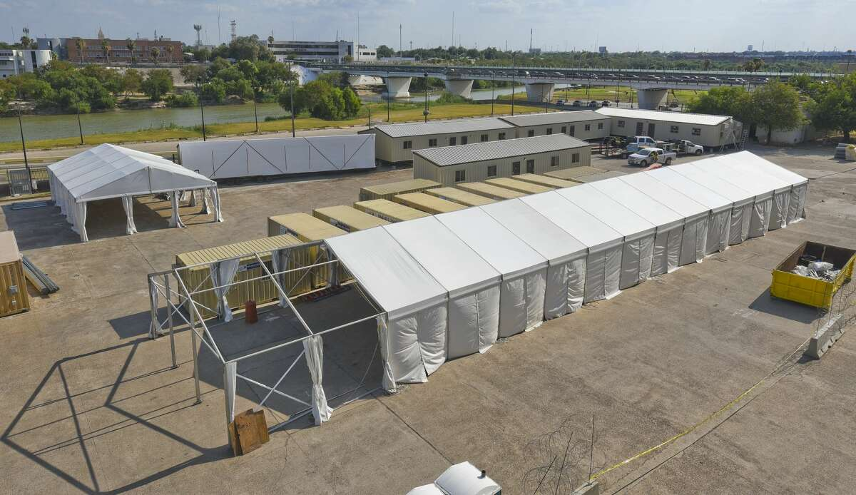 Portable buildings and tents intended for migrants seeking asylum are set up in the area between Juarez-Lincoln International Bridge and Gateway to the Americas International Bridge as seen on Wednesday, Jul 24, 2019.