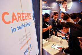 Job seekers interact with Human Resources and hiring officials of various corporate companies during a day-long career fair held exclusively for women and LGBTQ community in Bangalore on July 20, 2019. (Photo by MANJUNATH KIRAN / AFP)MANJUNATH KIRAN/AFP/Getty Images