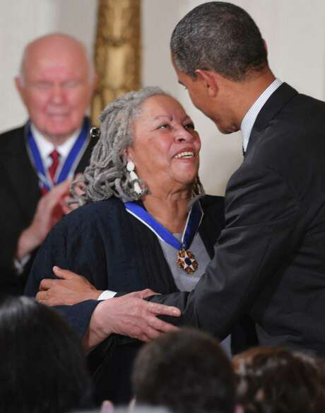"In this file photo taken on May 29, 2012, President Barack Obama congratulates author Toni Morrison after presenting her with the Presidential Medal of Freedom during a ceremony in the East Room of the White House in Washington. Obama paid tribute on Aug. 6, 2019, to Nobel Laureate Toni Morrison who died aged 88 following a short illness, describing her as ""a national treasure."" ""Her writing was a beautiful, meaningful challenge to our conscience and our moral imagination. What a gift to breathe the same air as her, if only for a while,"" he wrote on Twitter."