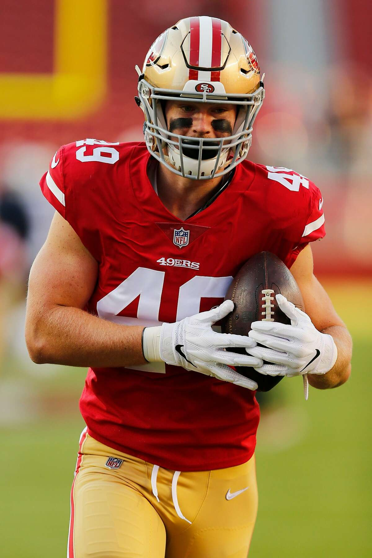 San Francisco 49ers tight end Ross Dwelley (49) warms up before an NFL preseason game against the Los Angeles Chargers at Levi's Stadium on Thursday, Aug. 30, 2018, in Santa Clara, Calif.