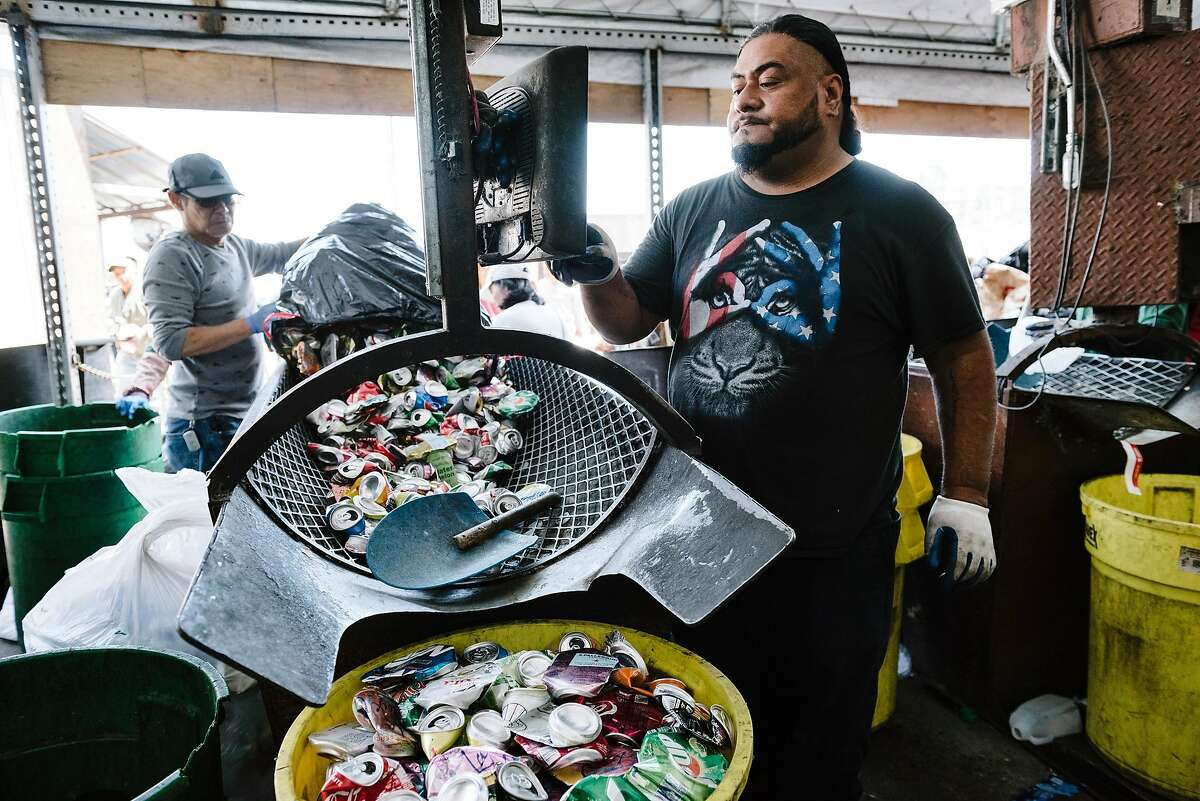 EmployeeIakopo Iakopoweighs a customers aluminum cans at Our Planet Recycling in San Francisco, Calif, on Tuesday, August 6, 2019.