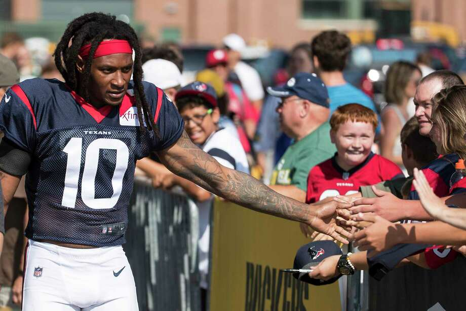 PHOTOS: Texans training camp  Houston Texans wide receiver DeAndre Hopkins (10) slaps hands with fans as he makes his way to a joint training camp practice with the Green Bay Packers on Tuesday, Aug. 6, 2019, in Green Bay, Wis. >>>See photos from the Texans' joint practice with the Packers on Tuesday ...  Photo: Brett Coomer, Houston Chronicle / Staff Photographer / © 2019 Houston Chronicle