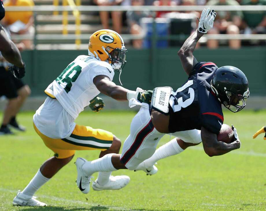 PHOTOS: Texans training camp  Houston Texans wide receiver Tyron Johnson (13) makes a catch and turns the ball upfield against Green Bay Packers cornerback Kabion Ento (48) during a joint training camp practice with the Green Bay Packers on Tuesday, Aug. 6, 2019, in Green Bay, Wis. >>>See photos from the Texans' joint practice with the Green Bay Packers on Tuesday, Aug. 6, 2019 in Green Bay, Wis. ... Photo: Brett Coomer, Houston Chronicle / Staff Photographer / © 2019 Houston Chronicle
