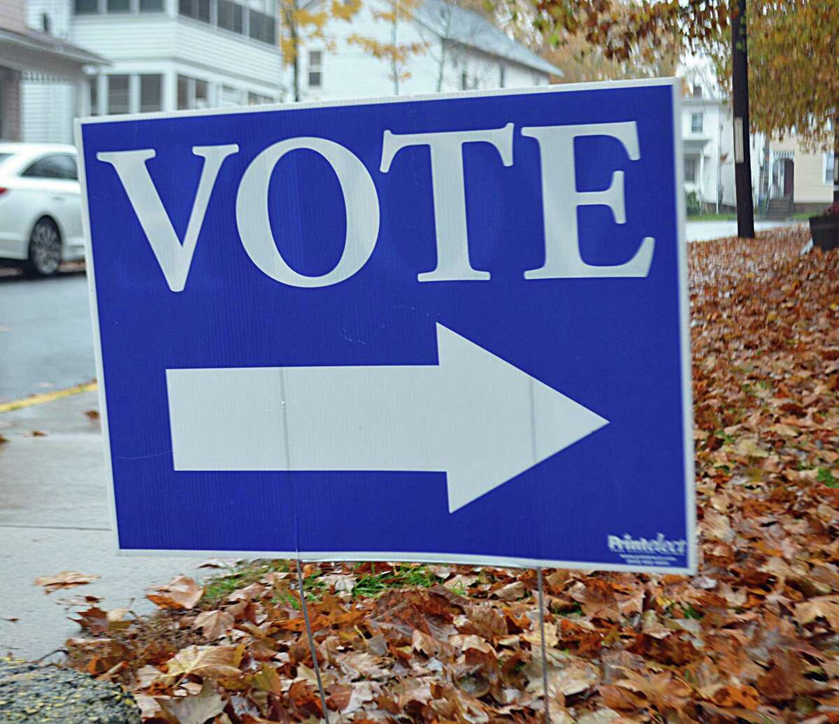 With about 60 people running for election Nov. 5 between two Democratic slates and the Republican roster, residents will be selecting among a diverse pool of political hopefuls. Here, a voting sign directs people to the Macdonough Elementary School gymnasium in Middletown.