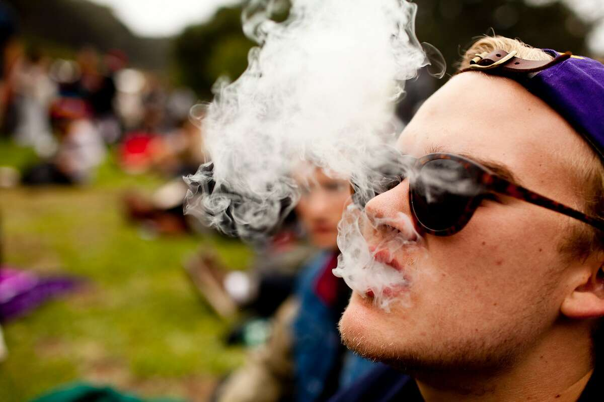 A reveler smokes marijuana on the field by the Twin Peaks stage at the 2012 Outside Lands Music Festival in Golden Gate Park in San Francisco, Calif., Friday, August 10, 2012. Jason Henry