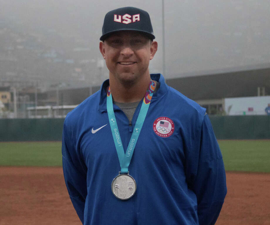 Team USA's Jeff Nowaczyk poses with the silver medal that he won in men's fastpitch softball at this summer's Pan American Games in Lima, Peru. Photo: USA Softball