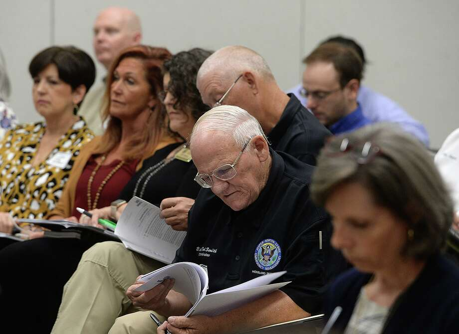 Paricipants, including Billy Ted Smith, gather for a community workshop on flood planning hosted by the Texas Water Development Board Tuesday at Lamar State College Orange.