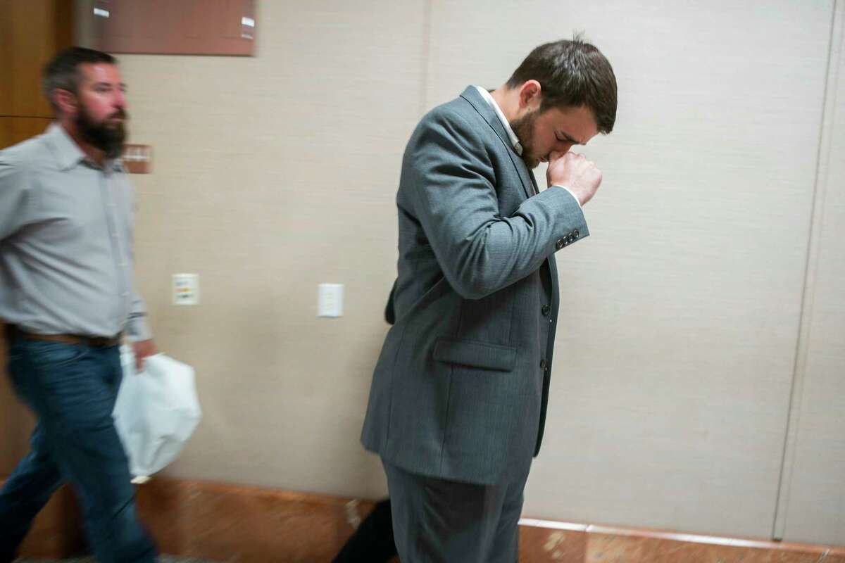 Evan Temple, son of David Temple, leaves the courtroom after his father David was found guilty in the 1999 killing of his wife, at the Harris County Criminal Courts building in downtown Houston, Tuesday, Aug. 6, 2019. Temple was serving a life sentence for the murder when his original verdict was overturned.