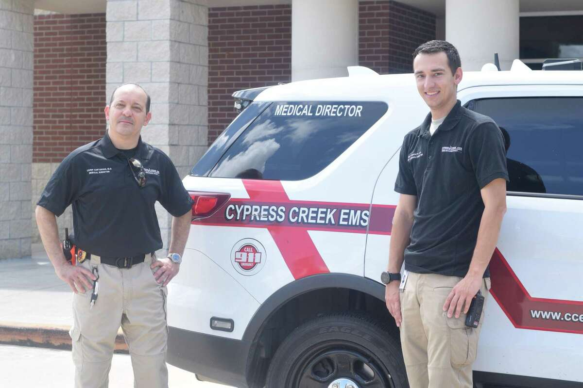 Matt Esposito (right) assists Levon Vartanian, medical director for Cypress Creek EMS, during his fellowship by working with staff on calls and participating in education.