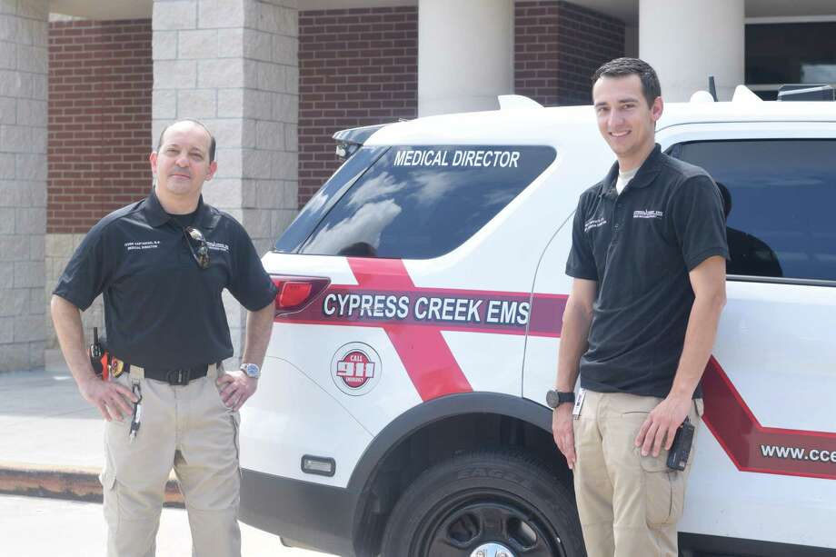 Matt Esposito (right) assists Levon Vartanian, medical director for Cypress Creek EMS, during his fellowship by working with staff on calls and participating in education. Photo: Chevall Pryce
