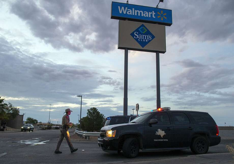 FILE - In this Aug. 4, 2019, file photo a Texas State Trooper walks back to his car while providing security outside the Walmart store in the aftermath of a mass shooting in El Paso, Texas.  Like most retailers, Walmart is accustomed to the everyday dealings of shoplifters. Now, it's confronting a bigger threat: active shooters. Days after a man opened fire at one of its stores in El Paso and left several dead, the nation's largest retailer is faced with how to make its workers and customers feel safe. (AP Photo/Andres Leighton, File) Photo: Andres Leighton, Associated Press
