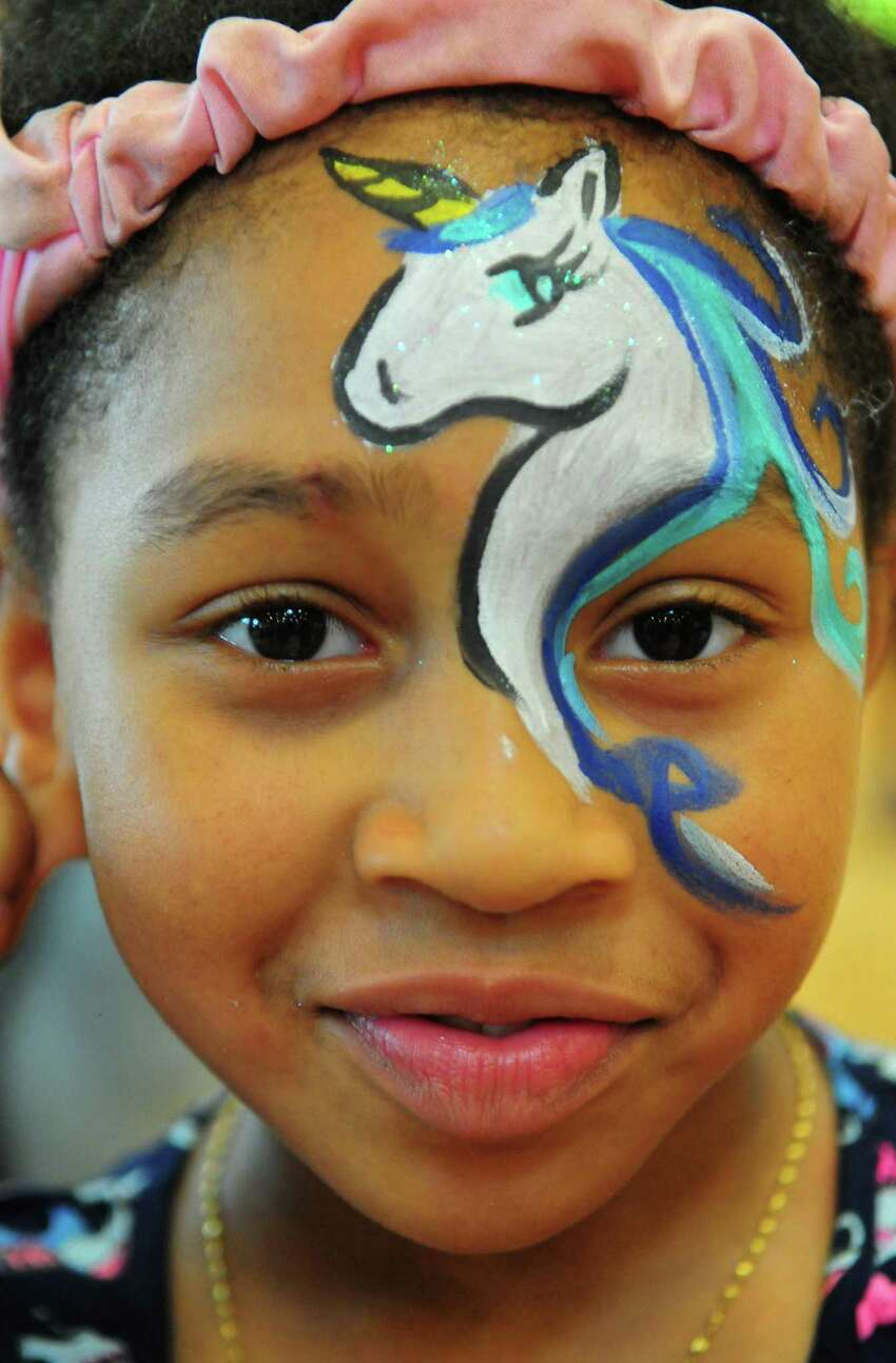 A'niyah Rivers, 10, shows off her unicorn face painting during the Elm City Communities/Housing Authority of New Haven's annual